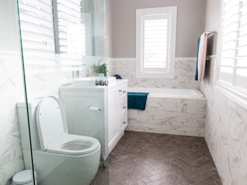Renting out with online payment: White Bathroom with Feature Tiles