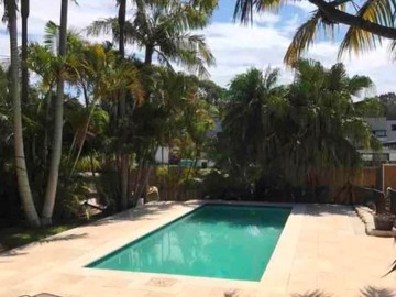 Renting out with online payment: Pool Area with limestone tiles and loungers